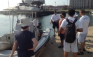 Students, veterans, and volunteers listen to a safety presentation provided by Conservation Officers from the Indiana Department of Natural Resources at the start of the 2012 sailing season.