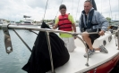 Indiana Sailing Association coach Geoffrey Barrow, on right, familiarizes Block Middle School eighth-grader Guillermo Domiguez with a sailboat July 27 during the orientation session of the Upwind learning program at the East Chicago Marina.